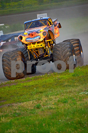 - Messenger photo by Britt Kudla<br /> Vern House driver of Fire Core Crusher, attempts to crush his jumps during the monster trunk show at Mineral city speedway on Friday night
