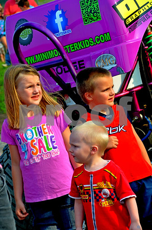 - Messenger photo by Britt Kudla<br /> (Left) Nevaeh Dietrich, Max Dietrich and Noah Witt enjoy their first monster truck event on  Friday night at the Mineral City Speedway