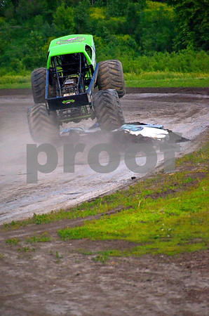 - Messenger photo by Britt Kudla<br /> Monster patrol driven by John the stunt man Furbee flies over a pack of cars on Friday night at the mineral city speedway track