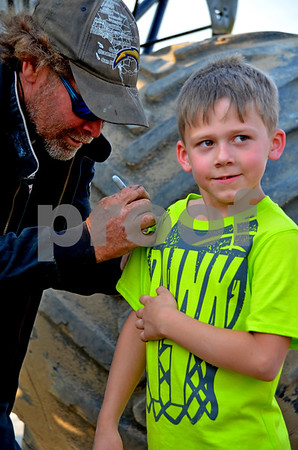 - Messenger photo by Britt Kudla<br /> (Left) John the Stunt Furbee treat Colin Kennebeck with an autograph on Friday night during the Monster truck event at Mineral city speedway