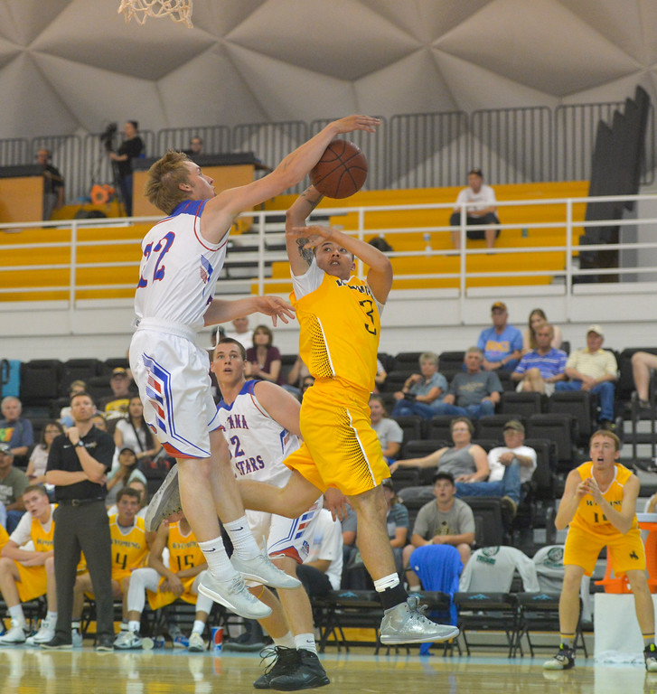 Justin Sheely | The Sheridan Press<br /> Montana'sTanner Haverfield blocks a shot by Wyoming's Buell Robinson during the boys Wyoming vs Montana All-Star Game Friday in the Bruce Hoffman Golden Dome at Sheridan College. Montana boys won 93-78.