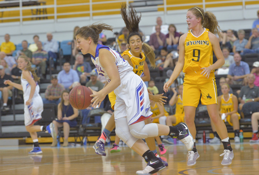 Justin Sheely | The Sheridan Press<br /> Montana's Nikki Krueger of Kalispell drives the ball against Wyoming's Kalina Smith, left, and Sierra Stellern during the girls Wyoming vs Montana All-Star Game Friday in the Bruce Hoffman Golden Dome at Sheridan College. Montana girls won 69-68.