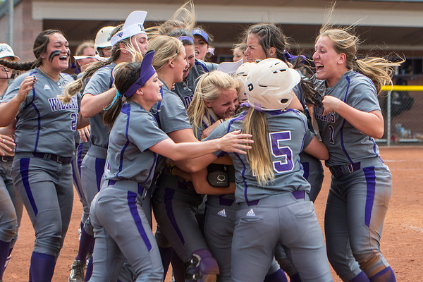 Weber State's softball team celebrates their victory over the Montana Grizzlies during the Big Sky Softball Championships at Weber State University on May 6, 2017.