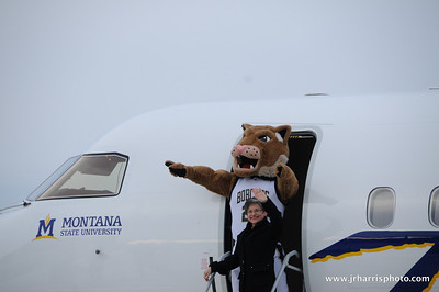 Montana State president Waded Cruzado and Champ at Gallatin Field airport in Belgrade Montana with the new Horizon Air MSU Bobcat plane