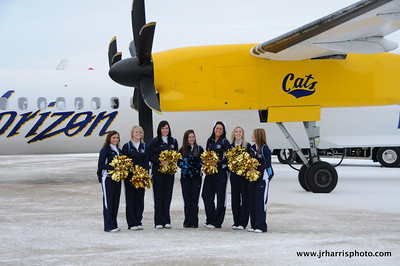 Montana State Cheerleaders at Gallatin Field airport in Belgrade Montana with the new Horizon Air MSU Bobcat plane