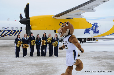 Montana State mascot Champ and the MSU Cheeleaders at Gallatin Field airport in Belgrade Montana with the new Horizon Air MSU Bobcat plane