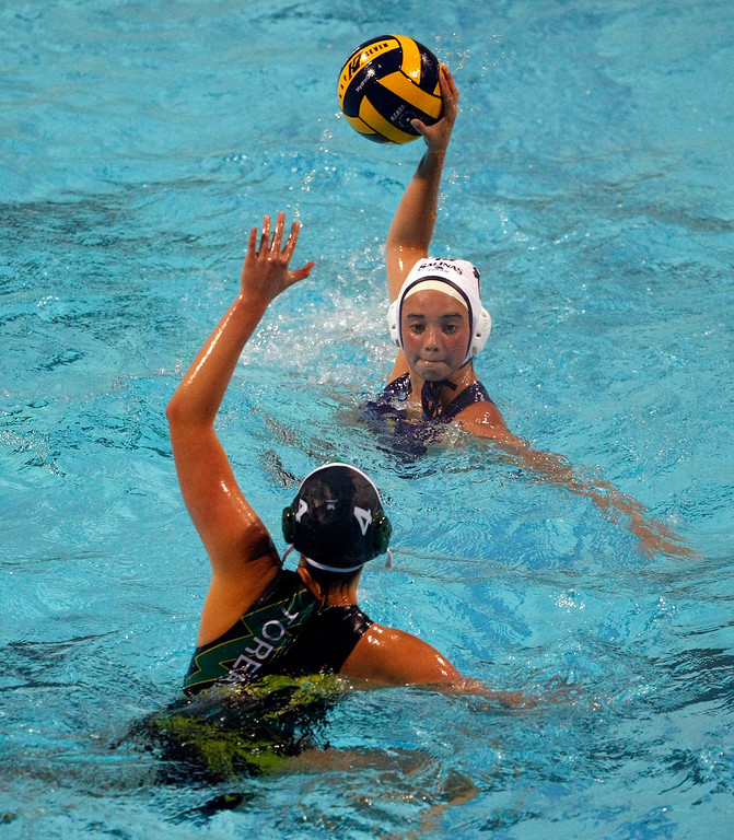 . Salinas\' #15 Sydney Clark tries to take a shot on goal as Monterey\'s #4 Colleen Mayone defends during their match on Oct. 22, 2013 at Santa Catalina School in Monterey.  (Vern Fisher/Monterey County Herald)