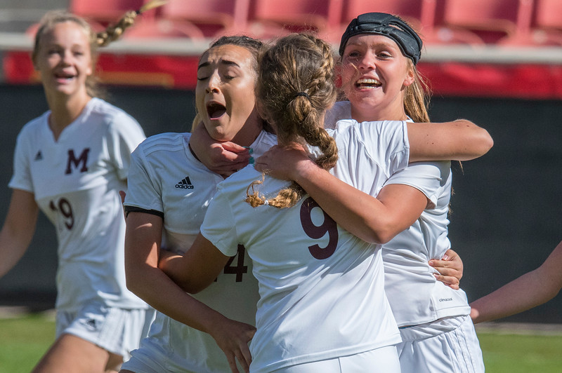 Morgan High School celebrates their early goal in the first half against the Judge Memorial  at Rio Tinto Stadium in Sandy, on October 21, 2017.
