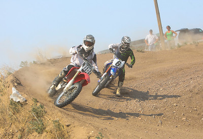 Andy Harwood of Crawford, NE out maneuvers  Travis Carroll of Ludell, Kansas in turn number five during race number six.