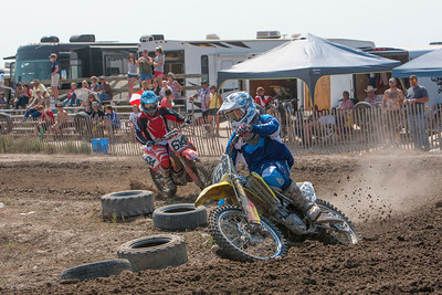 Tri State Dirt Riders - Riding in the 450cc Class C, Gering's David Sheldon leads on a turn over Cheyenne's Coleton Buchmeister is close behind. Sheldon won both races on the day for a total of 25 points added on his season total.