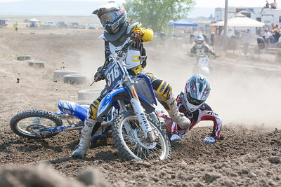 In race number five 85cc Class C, Scottsbluff's Zac Meier  loses the insde turn to (318) Laramie's Alex Culnan. Meier would place fifth in this race and with his second place finish in his first race would have take 16 points for the day.