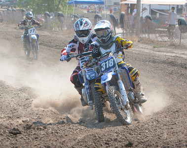 In race number five 85cc Class C, Scottsbluff's Zac Meier (left) loses the insde turn to (318) Laramie's Alex Culnan. Meier would place fifth in this race and with his second place finish in his first race would have take 16 points for the day.