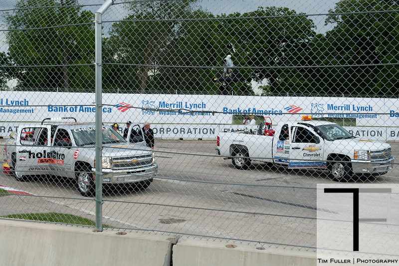 June 3, 2012; Detroit, MI, USA; Crews work to fix the track in turn six during a red flag at the Chevrolet Detroit Grand Prix at Belle Isle. Mandatory Credit: Tim Fuller-US PRESSWIRE