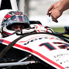 June 3, 2012; Detroit, MI, USA; IndyCar Series driver Will Power (12) gets strapped into his car before the Chevrolet Detroit Grand Prix practice at Belle Isle. Mandatory Credit: Tim Fuller-US PRESSWIRE