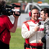 June 3, 2012; Detroit, MI, USA; IndyCar Series driver Dario Franchitti (10) is interviewed during a red flag at the Chevrolet Detroit Grand Prix at Belle Isle. Mandatory Credit: Tim Fuller-US PRESSWIRE