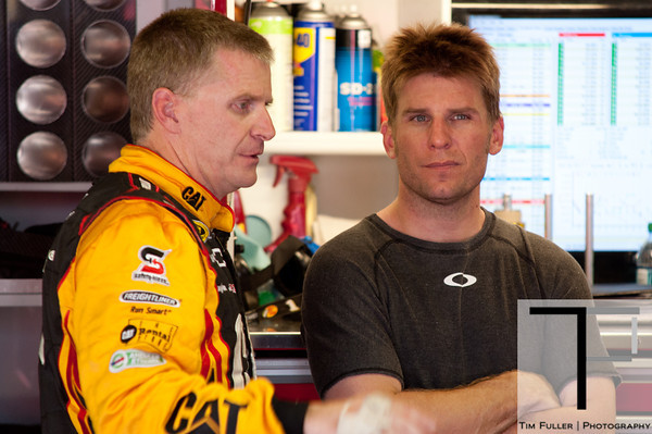 June 15, 2012; Brooklyn, MI, USA; NASCAR Sprint Cup Series driver Jamie McMurray (right) talks with driver Jeff Burton (left) during practice for the Quicken Loans 400 at Michigan International Speedway Mandatory Credit: Tim Fuller-US PRESSWIRE