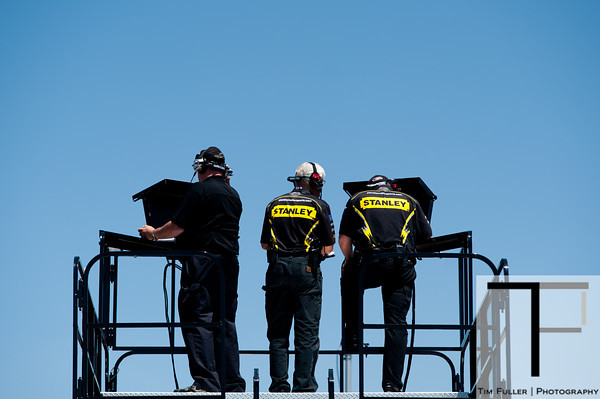 June 15, 2012; Brooklyn, MI, USA; Crew members of NASCAR Sprint Cup Series driver Marcos Ambrose (not pictured) during the practice for the Quicken Loans 400 at Michigan International Speedway Mandatory Credit: Tim Fuller-US PRESSWIRE