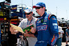 June 15, 2012; Brooklyn, MI, USA; NASCAR Sprint Cup Series driver Kyle Busch (18) signs autographs during practice for the Quicken Loans 400 at Michigan International Speedway Mandatory Credit: Tim Fuller-US PRESSWIRE