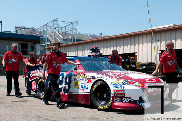 June 15, 2012; Brooklyn, MI, USA; Crew members push the car of NASCAR Sprint Cup Series driver Kevin Harvick (29) during practice for the Quicken Loans 400 at Michigan International Speedway Mandatory Credit: Tim Fuller-US PRESSWIRE