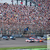 June 17, 2012; Brooklyn, MI, USA; NASCAR Sprint Cup Series driver Marcos Ambrose (9) leads the pack at the start of the Quicken Loans 400 at Michigan International Speedway. Mandatory Credit: Tim Fuller-US PRESSWIRE