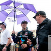 June 17, 2012; Brooklyn, MI, USA; NASCAR Sprint Cup Series driver Denny Hamlin (center) speaks with a fan before the Quicken Loans 400 at Michigan International Speedway. Mandatory Credit: Tim Fuller-US PRESSWIRE