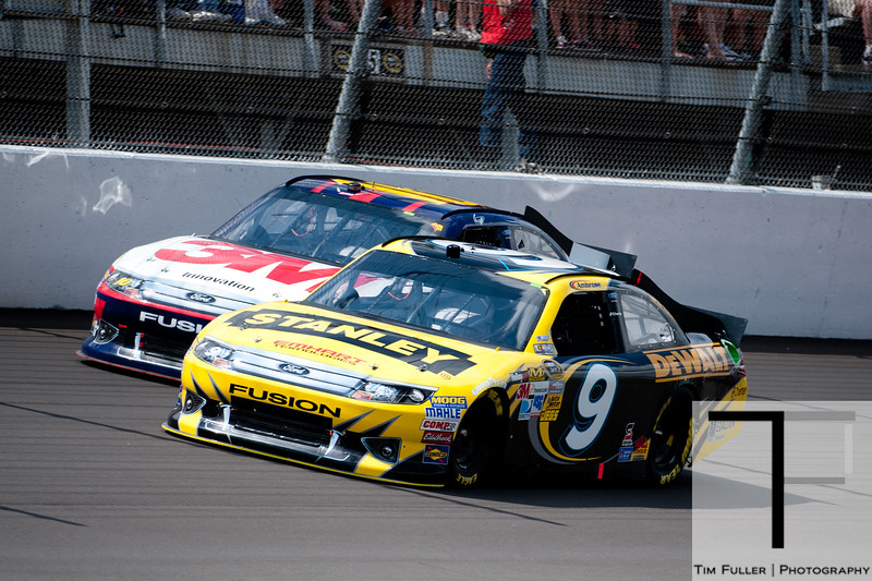 June 17, 2012; Brooklyn, MI, USA; NASCAR Sprint Cup Series driver Marcos Ambrose (9) and driver Greg Biffle (16) during the Quicken Loans 400 at Michigan International Speedway. Mandatory Credit: Tim Fuller-US PRESSWIRE