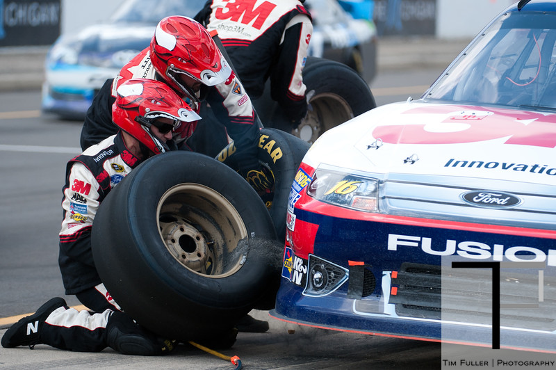 June 17, 2012; Brooklyn, MI, USA; NASCAR Sprint Cup Series driver Greg Biffle (16) has his tires changed during the Quicken Loans 400 at Michigan International Speedway. Mandatory Credit: Tim Fuller-US PRESSWIRE