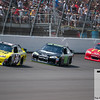 June 17, 2012; Brooklyn, MI, USA; NASCAR Sprint Cup Series driver Dave Blaney (36), driver Dale Earnhardt Jr. (88), and driver Jamie McMurray (1)  during the Quicken Loans 400 at Michigan International Speedway. Mandatory Credit: Tim Fuller-US PRESSWIRE
