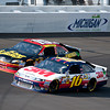June 17, 2012; Brooklyn, MI, USA; NASCAR Sprint Cup Series driver Greg Biffle (16) and driver Clint Bowyer (15) during the Quicken Loans 400 at Michigan International Speedway. Mandatory Credit: Tim Fuller-US PRESSWIRE