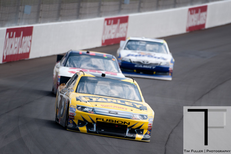 June 17, 2012; Brooklyn, MI, USA; NASCAR Sprint Cup Series drivers Marcos Ambrose (front), Greg Biffle (middle), and Mark Martin (back) during the Quicken Loans 400 at Michigan International Speedway. Mandatory Credit: Tim Fuller-US PRESSWIRE