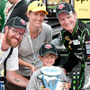 June 17, 2012; Brooklyn, MI, USA; NASCAR Sprint Cup Series driver Dale Earnhardt Jr. (88) poses with fans after the Quicken Loans 400 at Michigan International Speedway. Mandatory Credit: Tim Fuller-US PRESSWIRE