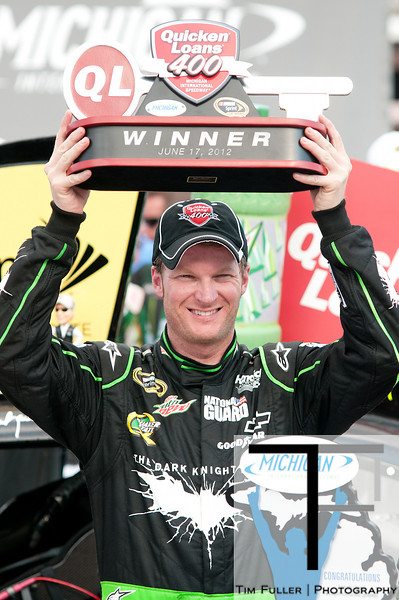 June 17, 2012; Brooklyn, MI, USA; NASCAR Sprint Cup Series driver Dale Earnhardt Jr. (88) celebrates his win in victory lane after the Quicken Loans 400 at Michigan International Speedway. Mandatory Credit: Tim Fuller-US PRESSWIRE