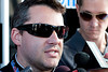 Aug 17, 2012; Brooklyn, MI, USA; NASCAR Sprint Cup Series driver Tony Stewart (14) is interviewed by the media after the practice for the Pure Michigan 400 at Michigan International Speedway. Mandatory Credit: Tim Fuller-US PRESSWIRE