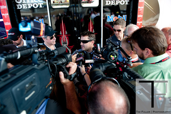 Aug 17, 2012; Brooklyn, MI, USA; NASCAR Sprint Cup Series driver Tony Stewart (14) is interviewed by media after the practice for the Pure Michigan 400 at Michigan International Speedway. Mandatory Credit: Tim Fuller-US PRESSWIRE