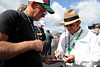 Aug 17, 2012; Brooklyn, MI, USA; NASCAR Sprint Cup Series owner Jack Roush (right) signs an autograph for a fan before the practice for the Pure Michigan 400 at Michigan International Speedway. Mandatory Credit: Tim Fuller-US PRESSWIRE