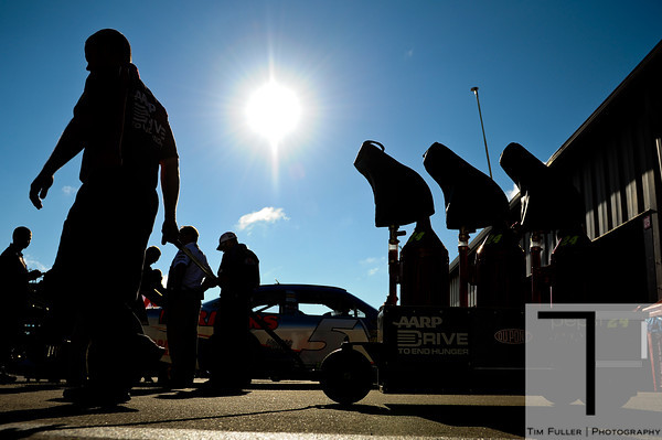 Aug 17, 2012; Brooklyn, MI, USA; A crew member of NASCAR Sprint Cup Series driver Jeff Gordon (24) pulls gas cans during practice for the Pure Michigan 400 at Michigan International Speedway. Mandatory Credit: Tim Fuller-US PRESSWIRE