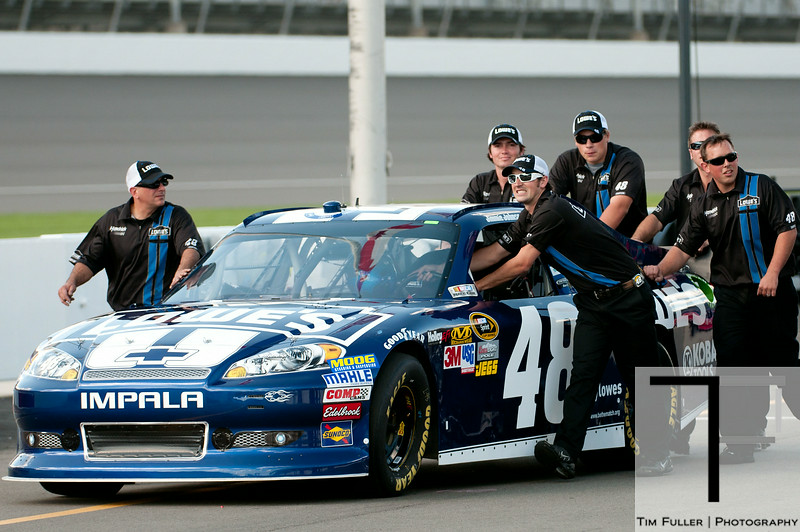 Aug 17, 2012; Brooklyn, MI, USA; Crew members push the car of NASCAR Sprint Cup Series driver Jimmie Johnson (48) onto pit lane during qualifying for the Pure Michigan 400 at Michigan International Speedway. Mandatory Credit: Tim Fuller-US PRESSWIRE