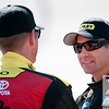 Aug 17, 2012; Brooklyn, MI, USA; NASCAR Sprint Cup Series driver Marcos Ambrose (right) talks with driver Clint Bowyer (left) during qualifying for the Pure Michigan 400 at Michigan International Speedway. Mandatory Credit: Tim Fuller-US PRESSWIRE
