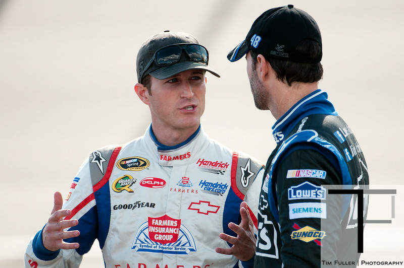 Aug 17, 2012; Brooklyn, MI, USA; NASCAR Sprint Cup Series driver Kasey Kahne (left) talks to driver Jimmie Johnson (right) during qualifying for the Pure Michigan 400 at Michigan International Speedway. Mandatory Credit: Tim Fuller-US PRESSWIRE