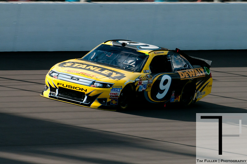 Aug 17, 2012; Brooklyn, MI, USA; NASCAR Sprint Cup Series driver Marcos Ambrose (9) during qualifying for the Pure Michigan 400 at Michigan International Speedway. Mandatory Credit: Tim Fuller-US PRESSWIRE