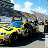Aug 17, 2012; Brooklyn, MI, USA; The car of NASCAR Sprint Cup Series driver Marcos Ambrose (9) is pushed onto pit lane by crew members during qualifying for the Pure Michigan 400 at Michigan International Speedway. Mandatory Credit: Tim Fuller-US PRESSWIRE