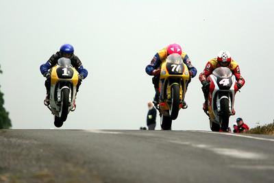 three bikes airborne,