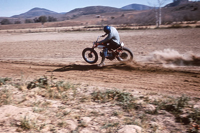 Stan Cole was an aggressive and hard rider.  He's riding on a track owned by his father.  Olivenhain, California.  1964