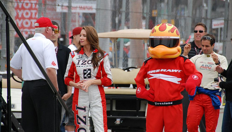 Cameron the IZOD girl with the Firestone Firehawk. No idea what Vitor Meira is up to behind the Firechicken...