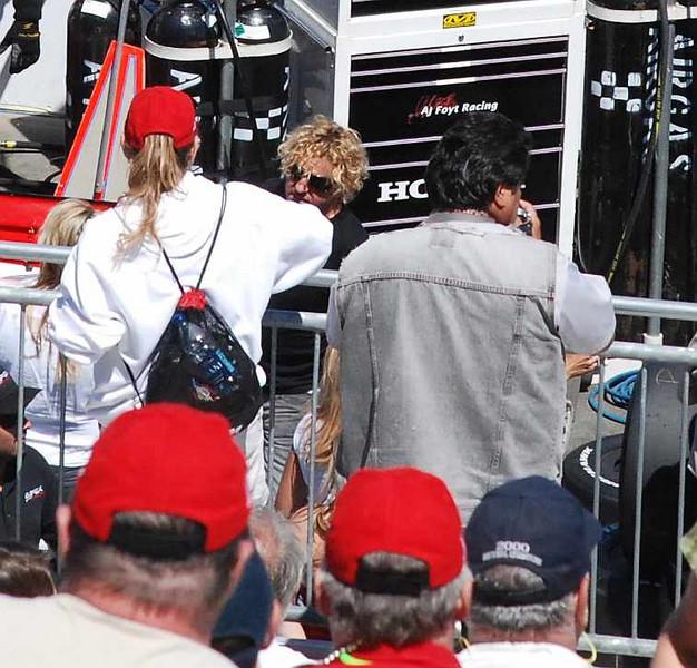 The curly blond mop belongs to Sammy Hagar...