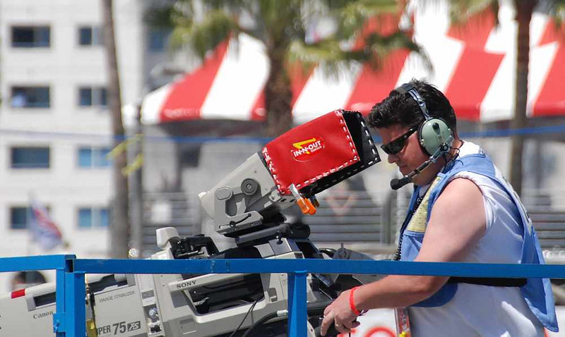 This camera man was right near my seat...his In-n-Out burger cover made me hungry all race long!