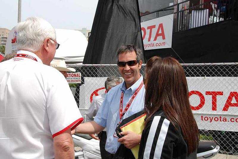 indy Racing League CEO Randy Bernard (blue shirt) speaks with Al Speyer of Firestone (silver hair),