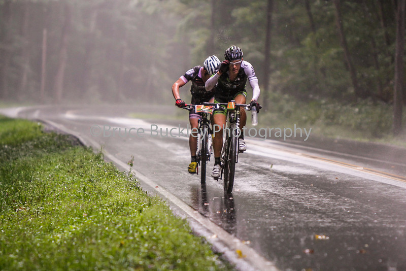 The sunshine was quickly wiped out by a fast-moving midday storm that drenched the course, hitting the leaders as they headed away from the Dowell Draft descent on U.S.250. Kevin Carter (Gripped Racing), front, adjusts his glasses to help keep his eyes on the road.