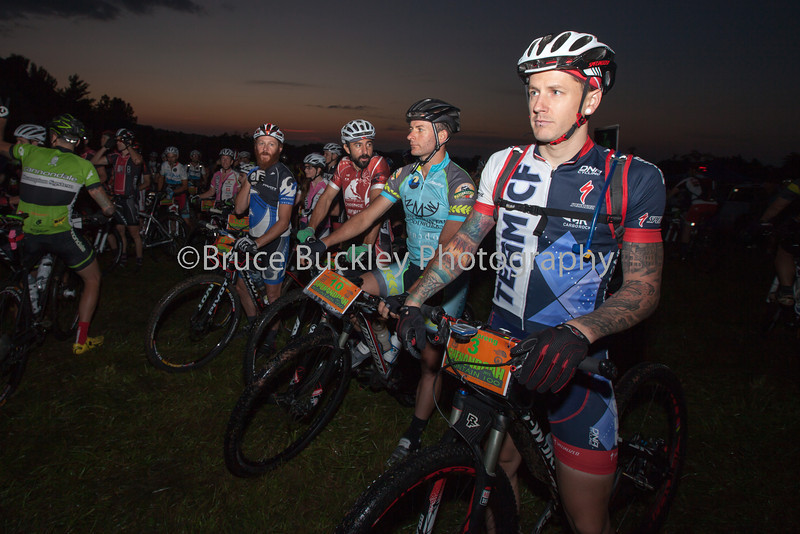 Rob Spreng (Team CF), right, and Andy Rhodes (North Mountain Woodworks/Black Dog Bikes), center, take their positions on the line for the dawn start of the Shenandoah Mountain 100.