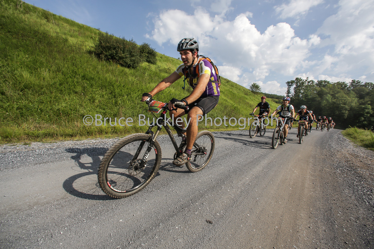 Mid-morning sun helped dry off riders as they pushed down Tilghman Road on the way to Hankey Mountain.